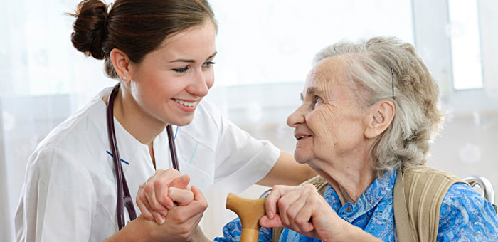 Senior woman with a health care worker in a nursing home.